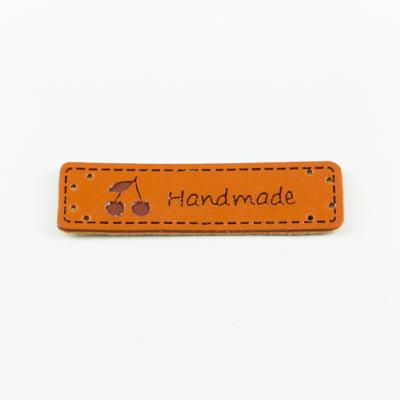 Hand made címke bőrutánzat 5×1,5 cm cseresznye