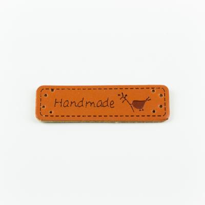 Hand made címke bőrutánzat 5×1,5 cm madárka