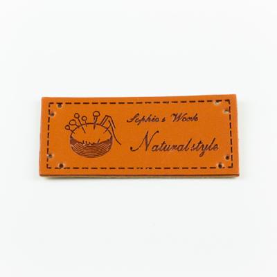 Hand made címke bőrutánzat 5,6×2,6 cm tűpárna