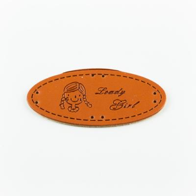 Hand made címke bőrutánzat ovális 5,7×2,5 cm lány