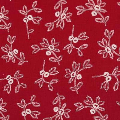 Pamutvászon fehér bogyós ágak piros alapon