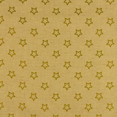 Pamutvászon karácsonyi arany csillagok drapp alapon