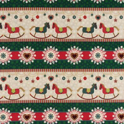 Pamutvászon karácsonyi hintalovas sorminta zöld árnyalatban